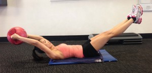 best ab exercises for a flat and toned stomach - medicine ball extensions